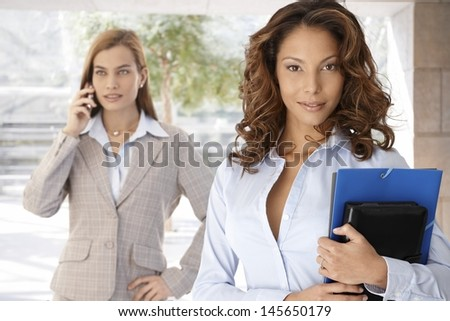 Outdoor portrait of attractive young businesswoman with personal organizer.