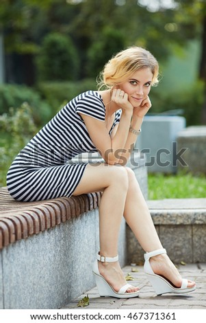 Outdoor portrait of beautiful blond young woman