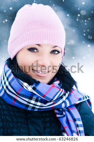 Outdoor portrait of beautiful smiling young girl in winter park - stock photo