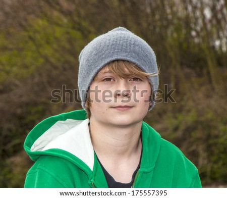 outdoor portrait of cool looking boy - stock photo