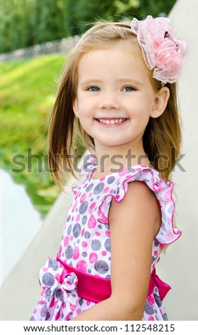 Outdoor portrait  of cute little girl in summer day - stock photo