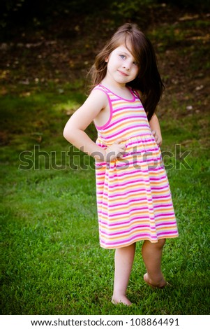 Outdoor portrait of cute young girl in park - stock photo