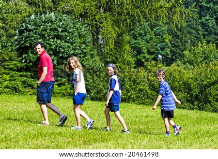 outdoor portrait of family on  a walk - stock photo