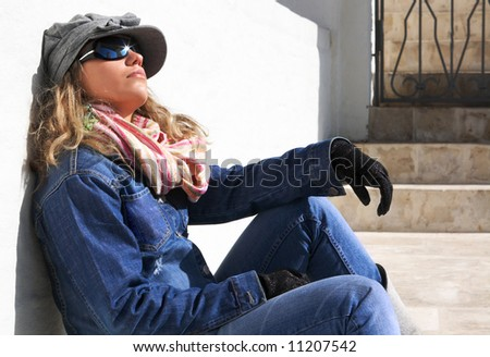 outdoor portrait of girl leaning against a wall