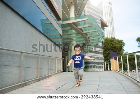 Outdoor portrait of happy little boy. Asian child outdoor at sunset - happy carefree childhood - stock photo