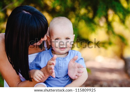 outdoor portrait of happy mother and son