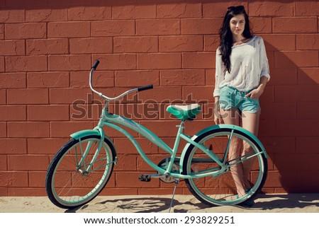 Outdoor portrait of happy woman biking in city park. Joy and happiness. Venice Beach - stock photo