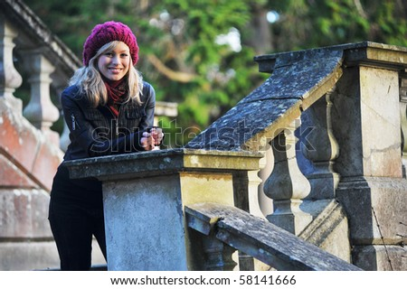 Outdoor Portrait Of Happy Young Woman - stock photo