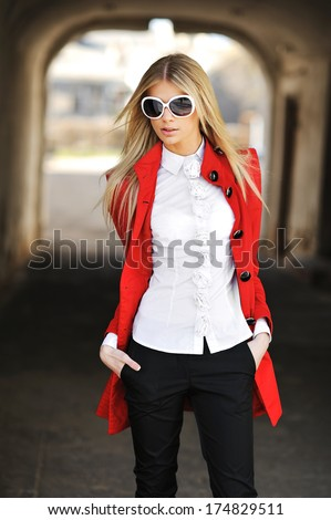Outdoor portrait of high fashion female posing in the city - stock photo