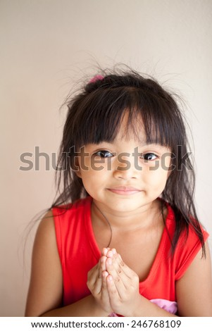 outdoor portrait of little girls.pay respect - stock photo