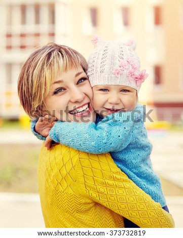outdoor portrait of mother and daughter. child and mom walk in the summer