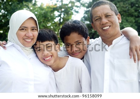 outdoor portrait of muslim family - stock photo