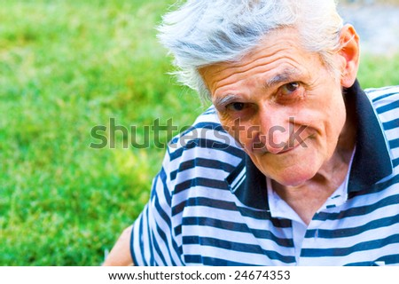 Outdoor portrait of one confident senior man - stock photo