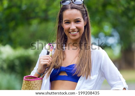 Outdoor portrait of Pretty spring woman in the garden