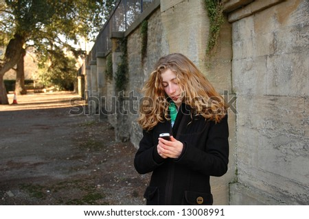 outdoor portrait of pretty teenager - stock photo