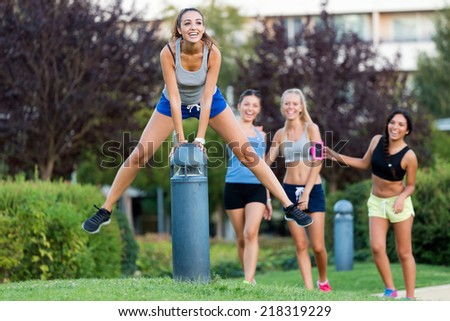 Outdoor portrait of running girls having fun in the park. - stock photo