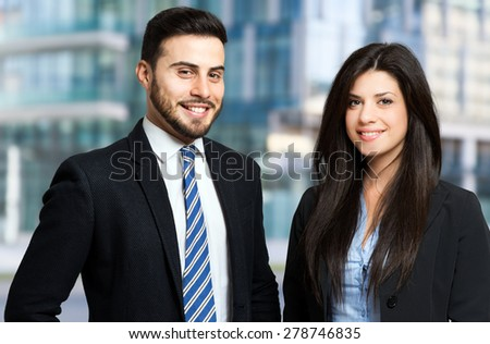Outdoor portrait of smiling business people - stock photo