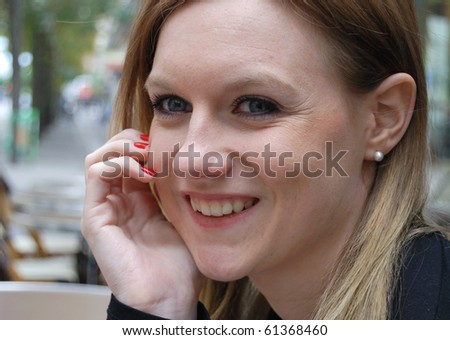 Outdoor portrait of smiling charming young woman