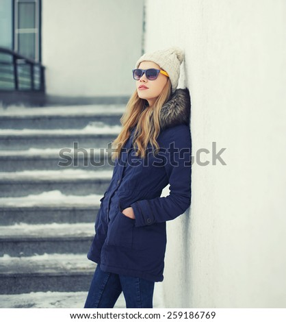 Outdoor portrait of stylish pretty hipster girl in the city, street fashion - stock photo