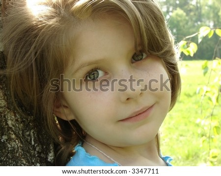outdoor portrait of the little pretty girl