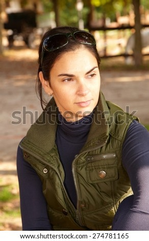 Outdoor portrait of thoughtful young woman looking away. - stock photo