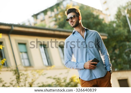 Outdoor portrait of trendy man in the city - stock photo