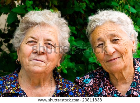 Outdoor portrait of two old ladies - stock photo