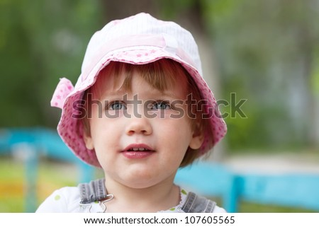 Outdoor portrait of  two-year child in summer