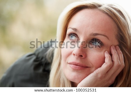 Outdoor Portrait Of Woman Wearing Winter Clothes - stock photo