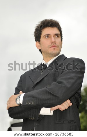Outdoor portrait of young and happy  businessman - stock photo