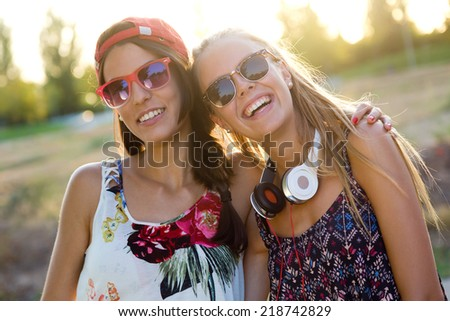 Outdoor portrait of young beautiful girls having fun in the park. - stock photo