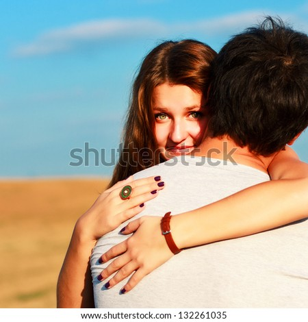 Outdoor Portrait of young couple in summer - stock photo