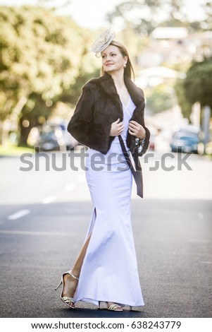 outdoor portrait of young gorgeous lady, woman in city, urban casual lifestyle shot
