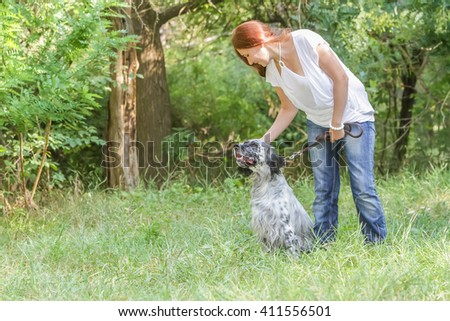 outdoor portrait of young happy woman with dog on natural background