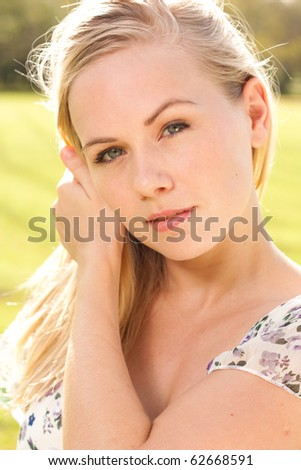 Outdoor portrait of young lady - stock photo