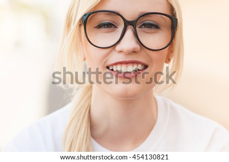 Outdoor portrait of young stylish hipster girl. Close up face, american, blonde, beautiful smile, white teeth, sunglasses, New York, happiness, relax, enjoy summer