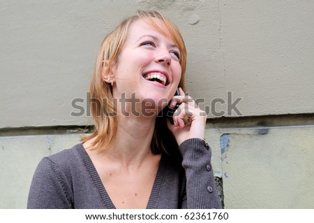 Outdoor portrait young woman with  cellular telephone