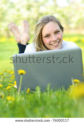 Outdoor portraits of beautiful smiling girl - stock photo