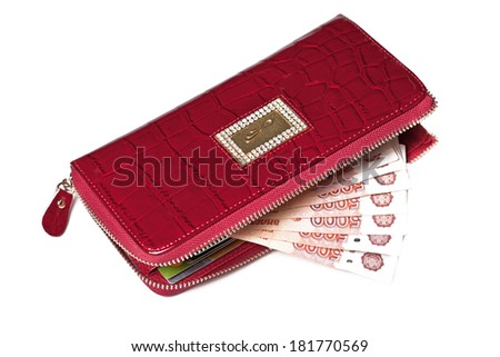 Outdoor red wallet with Russian rubles - stock photo