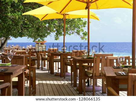 Outdoor restaurant at the beach - stock photo