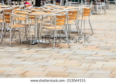 Outdoor restaurant coffee open air cafe chairs with table. Summer vacation on resort - stock photo