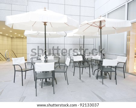 Outdoor restaurant in modern building - stock photo