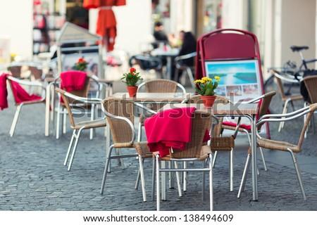 Outdoor restaurant in old european town - stock photo