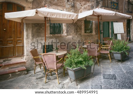 Outdoor restaurant in old european town, Siracusa, Sicily