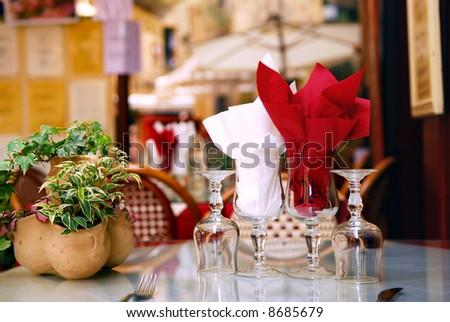 Outdoor restaurant patio on the street of Sarlat, Dordogne region, France - stock photo