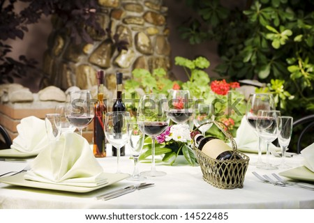 Outdoor restaurant table setting, copy space