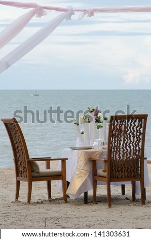 Outdoor restaurant tables, dinner setting on the beach