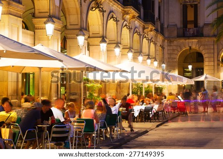 Outdoor restaurants at Placa Reial in  night. Barcelona  - stock photo