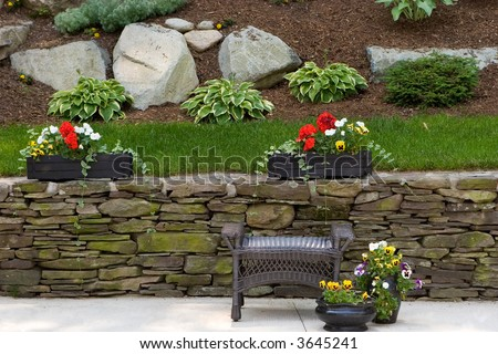 outdoor scene of a patio and garden behind - stock photo