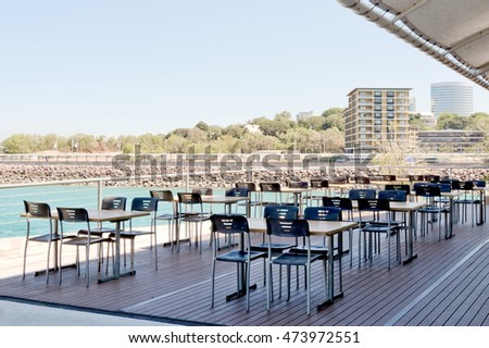 Outdoor seating area of a seaside cafe